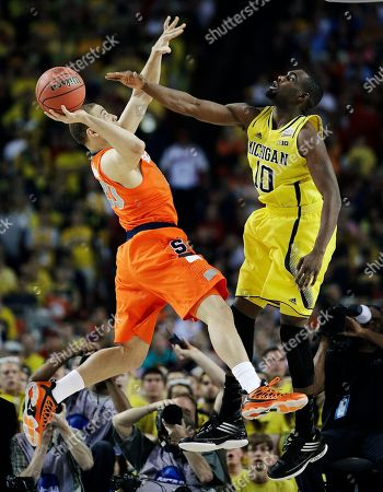Syracuse's Brandon Triche (20) shoots against Michigan's Tim Hardaway Jr. (10) during the first half of an NCAA Final Four tournament college basketball semifinal game, in Atlanta