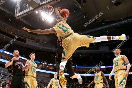 Demetrius Jackson, Scott Eatherton. Notre Dame's Demetrius Jackson (11) tries to block a shot by Northeastern's Scott Eatherton during the second half of an NCAA tournament second round college basketball game, in Pittsburgh