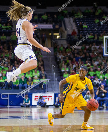 Hannah Huffman, Dana Brown. North Carolina A&T's Dana Brown (20) moves by Notre Dame's Hannah Huffman (24) after a fake during the second half of a first-round women's college basketball game in the NCAA Tournament, in South Bend, Ind