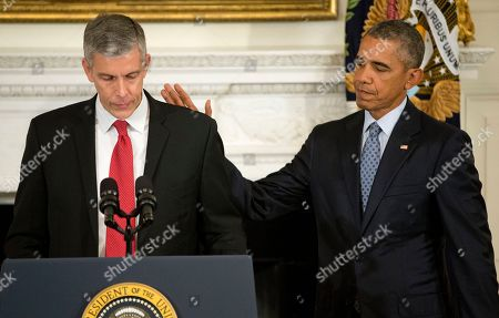 Barack Obama, Arne Duncan. President Barack Obama pats Education Secretary Arne Duncan's back in the State Dining Room of the White House in Washington, as Duncan announced that he will be stepping down in December after 7 years in the Obama administration. Duncan will be returning to Chicago and Obama has appointed senior Education Department official, John King Jr., to oversee the Education Department
