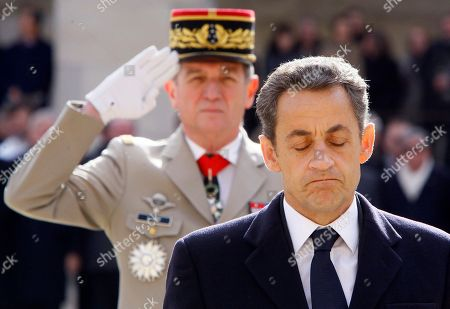 French President Nicolas Sarkozy pays respects to Raymond Aubrac, a major figure of the French Resistance during the funeral in Paris, . Aubrac who evaded the Nazis in a now-legendary escape led by his equally renowned wife, has died late Tuesday at Paris' Val-de-Grace military hospital. He was 97