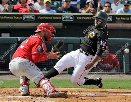 Cameron Rupp, Jason Rogers. Pittsburgh Pirates' Jason Rogers, right, tries to score ahead of the throw to Philadelphia Phillies catcher Cameron Rupp during the fifth inning of a spring training baseball game, in Tampa, Fla. Rogers was out at the plate trying to score on a hit by teammate Alen Hanson
