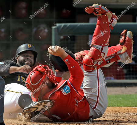 Jason Rogers, Cameron Rupp. Philadelphia Phillies catcher Cameron Rupp, right, hangs onto the ball after tagging out Pittsburgh Pirates' Jason Rogers, left, at home plate during the fifth inning of a spring training baseball game, in Tampa, Fla. Rogers was trying to score on a hit by Alen Hanson
