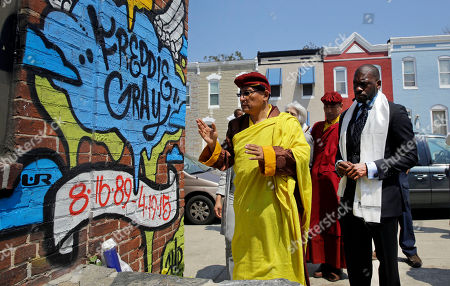 Stock Picture of Gyalwang Drukpa, Jamal Bryant. The Gyalwang Drukpa, left, the Buddhist leader of South Asia, prays at the site of Freddie Gray's arrest in Baltimore alongside the Rev. Jamal Bryant, right, and other faith and community leaders, . The group toured the neighborhood and visited a store that was damaged by fire during last month's unrest, following the death of Gray, who suffered a fatal spinal injury while in police custody