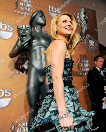 "Claire Danes poses with the trophy for best female actor in a television movie for her work on ""Temple Grandin"" at the 17th Annual Screen Actors Guild Awards on in Los Angeles"