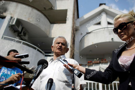 Milos Saljic, center, the lawyer of the family of Ratko Mladic, gives a press statement in front of a house owned by Ratko Mladic in a suburb of in Belgrade, Serbia, . Gen. Ratko Mladic, Europe's most wanted war crimes suspect, has been arrested in Serbia after years in hiding, the country's president said Thursday