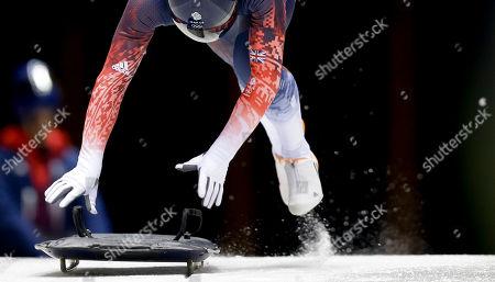 Britain's Kristian Bromley starts his training run prior to the 2014 Winter Olympics, in Krasnaya Polyana, Russia