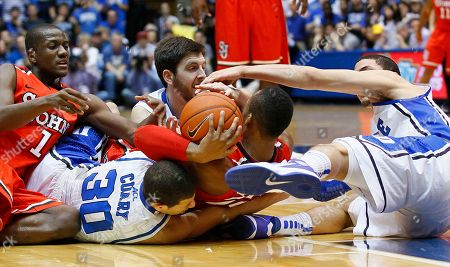 Seth Curry, Austin Rivers, Phil Greene, Amir Garrett, Ryan Kelly. Duke's Seth Curry (30), Austin Rivers, right, and Ryan Kelly, rear center, struggle for possession against St. John's Phil Greene (1) and Amir Garrett during the first half of an NCAA college basketball game in Durham, N.C