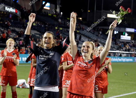 Nadine Angerer, Rachel Van Hollebeke. Portland Thorns goalkeeper Nadine Angerer, left, and defender Rachel Van Hollebeke celebrate after an NWSL soccer match against the Washington Spirit in Portland, Ore., . Both players have announced their retirement from soccer. The teams tied 3-3