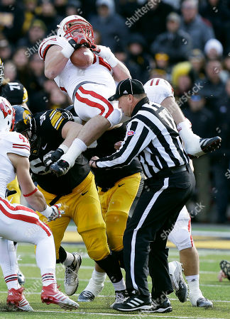 Conor Boffeli, Pat Muldoon. Wisconsin defensive end Pat Muldoon, top, intercepts a pass over Iowa offensive lineman Conor Boffeli, center, during the second half of an NCAA college football game, in Iowa City, Iowa. Wisconsin won 28-9