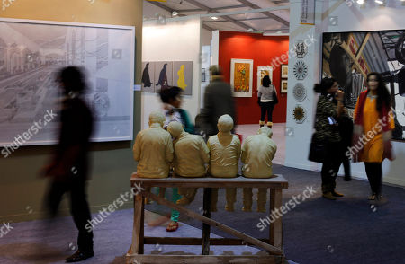 Stock Picture of Visitors walk past sculpture by Jitish Kallat at the sixth India Art Fair in New Delhi, India, . The sixth edition of India Art Fair, which runs from Jan. 30 to Feb. 2, showcases best Indian and International contemporary art featuring 91 exhibitors and 1,000 artists
