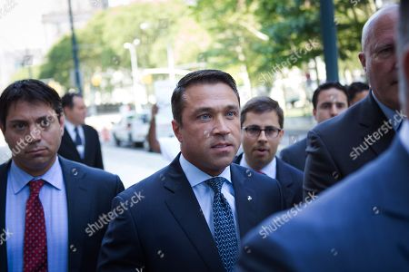 Former U.S. Rep. Michael Grimm, center, arrives ahead of his sentencing at federal court, in the Brooklyn borough of New York. Grimm pleaded guilty late last year to aiding in filing a false tax return, a charge that stemmed from an investigation into the Staten Island Republican's campaign financing