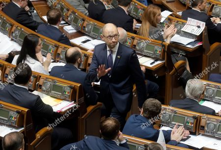 Arseniy Yatsenyuk leaves the parliament's hall after his resignation during the Ukrainian parliament session in Kiev, Ukraine, . Ukraine's parliament has endorsed Arseniy Yatsenyuk's resignation and appointed Volodymyr Groysman as the new prime minister