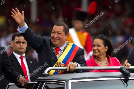 Hugo Chavez, Rosa Virginia Chavez. Venezuela's President Hugo Chavez waves next to his daughter Rosa Virginia during a military parade commemorating the 20th anniversary of the failed coup attempt that launched his political career in Caracas, Venezuela, . Chavez was an army paratroop commander when he led the failed attempt to topple the government of President Carlos Andres Perez on Feb. 4, 1992. Chavez was jailed and later pardoned