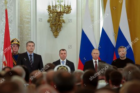 Vladimir Putin, Vladimir Konstantinov, Sergei Aksyonov, Alexei Chalyi. Russian President Vladimir Putin, second right, Speaker of Crimean legislature Vladimir Konstantinov, second left, Crimean Premier Sergei Aksyonov, left, and Sevastopol mayor Alexei Chalyi, right, stand at a signing ceremony for the treaty to join Crimea with Russia in the Kremlin, Moscow, . President Vladimir Putin on Tuesday signed a treaty to incorporate Crimea into Russia, describing the move as the restoration of historic injustice and a necessary response to what he called the Western encroachment on Russia's vital interests