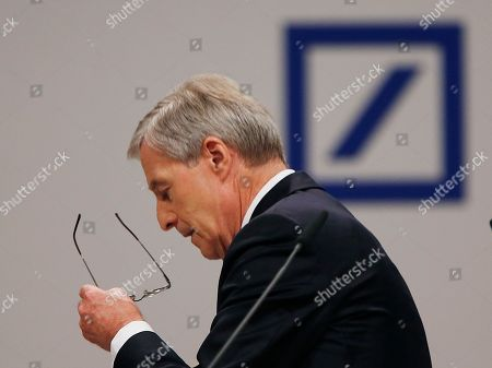 Outgoing Co-CEO of Deutsche Bank Juergen Fitschen leaves the lectern on his last day as CEO during the bank's annual shareholders meeting in Frankfurt, Germany