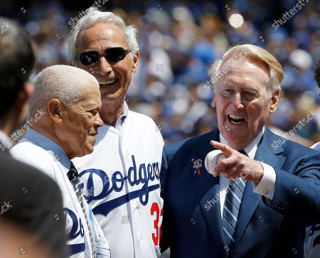 Vin Scully, Sandy Koufax, Maury Wills. Los Angeles Dodgers broadcaster Vin Scully, right, points to another former player, with Sandy Koufax, center, and Maury Wills, left, before the start of an opening day baseball game between the Los Angeles Dodgers and Arizona Diamondbacks in Los Angeles
