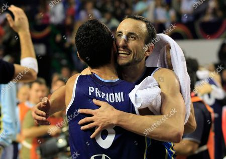 Stock Photo of Argentina's Emanuel 'Manu' Ginobili, right, embraces teammate Pablo Prigioni in celebration of their 80-75 victory over Brazil in their FIBA Americas Championship final basketball game in Mar del Plata, Argentina