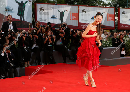 Stock Image of Actress Miori Takimoto laughs as she poses for photographers during the red carpet for the film The Wind Rises at the 70th edition of the Venice Film Festival held from Aug. 28 through Sept. 7, in Venice, Italy