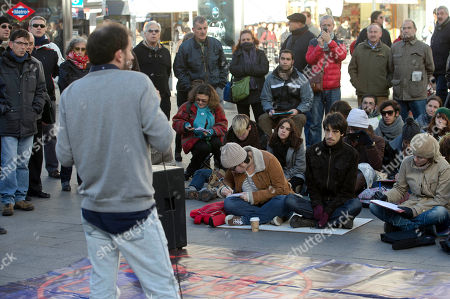 Professor Antonio de Cabo de la Vega, foreground gives a Constitutional law class to university students in the street in Madrid, . Professors are giving classes in the street all over Madrid Wednesday to highlight the need to protect the public university