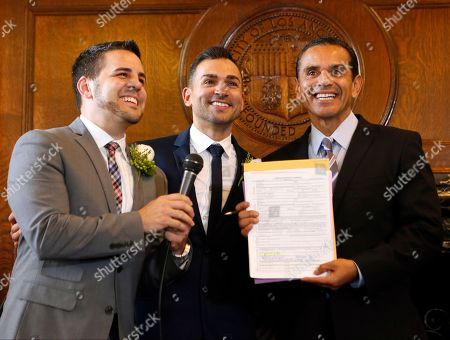 "Jeff Zarrillo, Paul Katami, Antonio Villaraigosa. Jeff Zarrillo, left, and Paul Katami, center, pose for photos after being married by Los Angeles Mayor Antonio Villaraigosa, at City Hall in Los Angeles. A three-judge panel of the 9th U.S. Circuit Court of Appeals issued a brief order Friday afternoon dissolving, ""effective immediately,"" a stay it imposed on gay marriages while the lawsuit challenging the ban advanced through the courts"