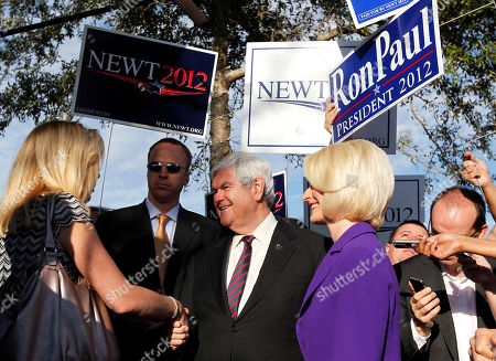 Newt Gingrich, Callista Gingrich, Michael Reagan. Republican presidential candidate, former House Speaker Newt Gingrich, accompanied by his wife Callista, campaigns outside a polling place at the First Baptist Church of Windermere in Orlando, Fla