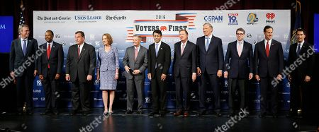 Republican presidential candidates gather on stage before a forum, in Manchester, N.H. From left: Jeb Bush, Ben Carson, Chris Christie, Carly Fiorina, Lindsey Graham, Bobby Jindal, John Kasich, George Pataki, Rick Perry, Rick Santorum, and Scott Walker