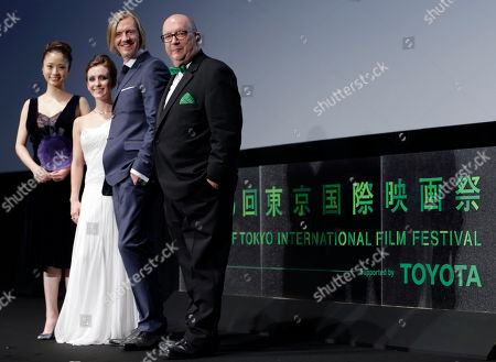 """Aya Ueto, Erica Linz, Andrew Adamson, Jacques Methe. From right, executive producer Jacques Methe, director Andrew Adamson and actress Erica Linz of their 3D film """"Cirque du Soleil: Worlds Away"""" pose with Aya Ueto, Japanese actress and the official navigator of the Tokyo International Film Festival at the opening ceremony of the film festival, in Tokyo"""