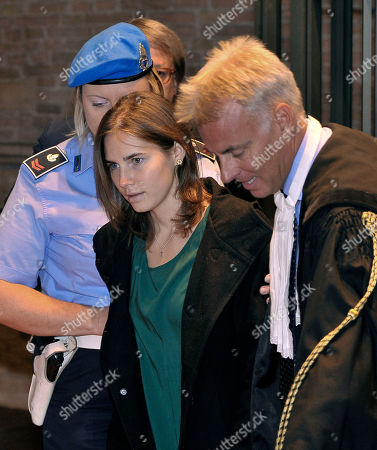 Amanda Knox, accompanied by her lawyer Carlo Dalla Vedova, arrives for an appeal hearing at the Perugia court, central Italy, . A tearful Amanda Knox has told an appeals court in Italy that accusations that she killed her British roommate are unfair and groundless. Knox fought back tears as she addressed the court Monday, minutes before the jury went into deliberations to decide whether to uphold her murder conviction. A verdict is expected later in the day
