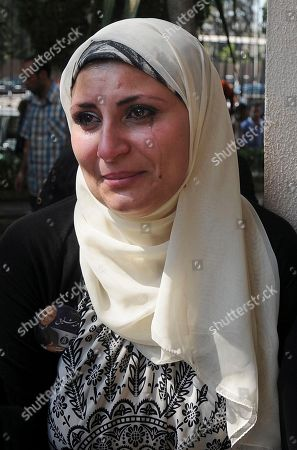 Women mourn at the funeral for Egypt's former spy chief, Omar Suleiman in Cairo, Egypt, . Egypt's top military commander and mourners attended a military funeral honoring Suleiman, who died in a U.S. hospital at the age of 76