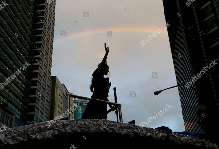 A rainbow appears over newly crowned Miss Universe Pia Alonzo Wurtzbach waving from her float in the financial district of Makati city, east of Manila, Philippines for a victory parade . Wurtzbach returned home to the Philippines for the first time since her crowning - and that awkward moment when host Steve Harvey mistakenly crowned Miss Colombia instead of her in Las Vegas on Dec. 20, 2015. Thousands of Filipinos lined the parade route to take a glimpse of the third Filipino to be crowned Miss Universe