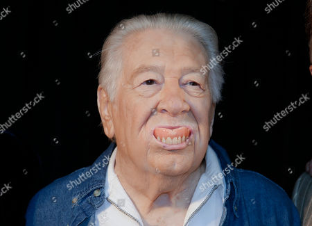 Jack Clement pops his false teeth out as he jokes with photographers, in Nashville, Tenn., after it was announced that he will be inducted into the Country Music Hall of Fame. Clement will be inducted along with Bobby Bare and Kenny Rogers