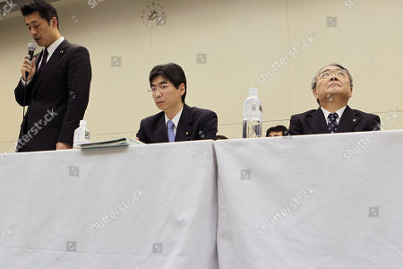 "Toshio Nishizawa, Goshi Hosono, Yasushi Sonoda. Tokyo Electric Power Co. President Toshio Nishizawa, right, looks up as Japan's Nuclear Crisis Minister Goshi Hosono, left, speaks during a press conference at the headquarters of TEPCO, the operator of the tsunami-damaged Fukushima Dai-ichi nuclear power plant, in Tokyo, shortly after Japan's prime minister announced that the nuclear plant has achieved a stable state of ""cold shutdown,"" a crucial step toward the eventual lifting of evacuation orders and closing of the plant. Nishizawa apologized for the accident, and vowed to further stabilize the plant and reduce its radiation release until the operator finally put it to a close. Seated in the middle is Yasuhiro Sonoda, Japan's parliamentary secretary of cabinet office"