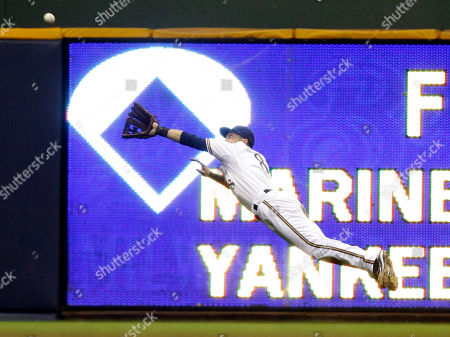 Milwaukee Brewers' Ryan Braun makes a diving catch on a ball hit by San Diego Padres' Scott Hairston during the sixth inning of a baseball game, in Milwaukee