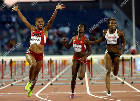 USA's Queen Harrison celebrates as she crosses the finish line to win the women's 100 meter hurdles at the Pan Am Games in Toronto, . Harrison won the gold medal in the event