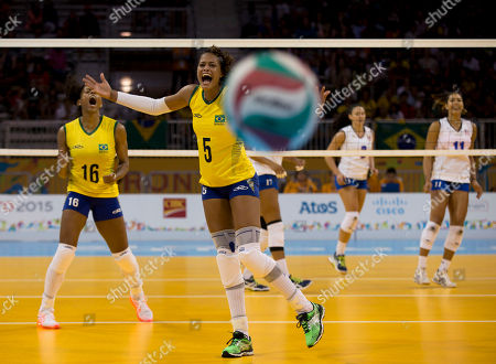 Adenizia Da Silva, Fernanda Rodrigues. Brazil's Adenizia Da Silva, center, and Fernanda Rodrigues, left, react as a strike from Puerto Rico goes out of bounds, in one of the five set's final points during their preliminary match at the Pan Am Games in Toronto