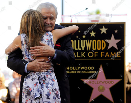 Jennifer Aniston, John Aniston. Actress Jennifer Aniston is embraced by her father, actor John Aniston, after she received a star on the Hollywood Walk of Fame in Los Angeles