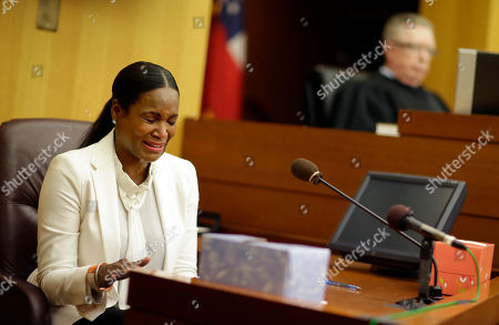 Tameka Foster Raymond, left, reacts after the playing of a 911 tape from when her son got caught in a pool drain during a child custody hearing with her ex-husband, R&B singer Usher, in Atlanta. A judge in Atlanta is set to hear arguments in the child custody battle between Usher and his ex-wife. Tameka Foster Raymond requested the hearing earlier this week after the former couple's son got caught in a pool drain while in the care of the Grammy winner's aunt