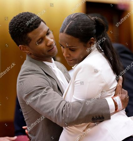 Stock Image of Usher, Tameka Foster Raymond. R&B singer Usher, left, embraces ex-wife Tameka Foster Raymond, after a judge dismissed an emergency request by Raymond seeking temporary custody of their two children, in Atlanta. Raymond had requested the hearing earlier this week after their 5-year-old son got caught in a pool drain while in the care of the Grammy winner's aunt. After a hearing in which both Usher and Raymond took the stand, Fulton County Superior Court Judge John Goger dismissed her request for temporary primary custody and decision-making authority