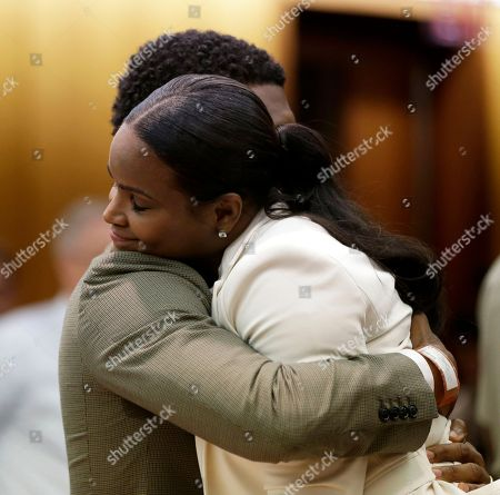 Usher, Tameka Foster Raymond. R&B singer Usher, left, embraces ex-wife Tameka Foster Raymond, after a judge dismissed an emergency request by Raymond seeking temporary custody of their two children, in Atlanta. Raymond had requested the hearing earlier this week after their 5-year-old son got caught in a pool drain while in the care of the Grammy winner's aunt. After a hearing in which both Usher and Raymond took the stand, Fulton County Superior Court Judge John Goger dismissed her request for temporary primary custody and decision-making authority