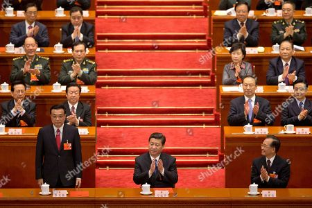 Li Keqiang, Xi Jinping, Wen Jiabao. Newly-named Chinese Premier Li Keqiang stands up when he was announced to be the nation's new premier, while Chinese President Xi Jinping, center, and former Chinese Premier Wen Jiabao, front right, clap with delegates and other top Chinese leaders during a plenary session of the National People's Congress held in Beijing's Great Hall of the People