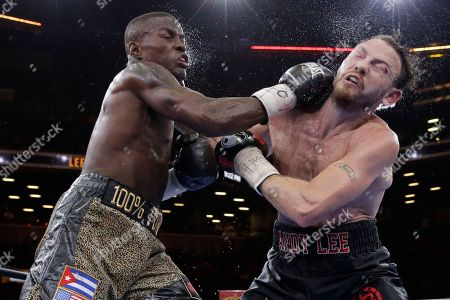 Peter Quillin, Andy Lee. Peter Quillin lands a punch on Andy Lee in the eighth round during a middleweight boxing match, in New York. The match ended in a draw