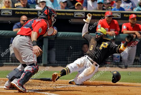 Josh Harrison, Ryan Hanigan. Pittsburgh Pirates' Josh Harrison, right, scores in front of Boston Red Sox catcher Ryan Hanigan on an RBI single by Jason Rogers during the first inning of a spring training baseball game, in Bradenton, Fla