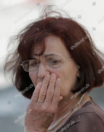 Bosiljka Mladic, the wife of genocide suspect Ratko Mladic reacts after exiting the Special Court building in Belgrade, Serbia, . Bosnian Serb military commander Ratko Mladic can be extradited to a U.N. tribunal on war-crimes charges despite defense claims he is too sick to face trial, a Belgrade court ruled Friday. A defense lawyer said Mladic would appeal the decision on Monday. The former fugitive could extradited within hours if that appeal is rejected. If Mladic is extradited, he will argue that he's innocent of war crimes charges that include orchestrating some of the worst atrocities of the 1992-1995 Bosnian war, the suspect's son indicated after visiting the former fugitive in jail
