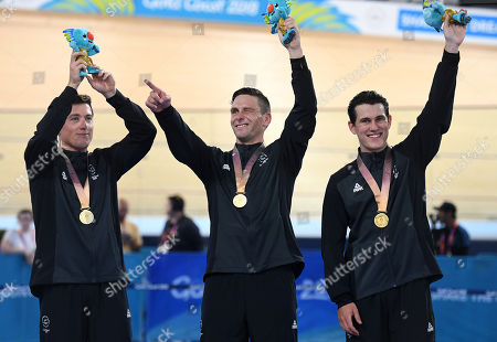 (L-R) New Zealand cyclists Ethan Mitchell, Edward Dawkins and Sam Webster celebrate gold in the Men's Team Sprint event at the XXI Commonwealth Games at the Anna Meares Velodrome in Brisbane, Australia, 05 April 2018.