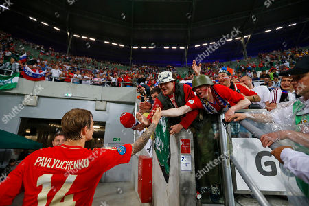 Russia's Roman Pavlyuchenko shakes hand with fans after the Euro 2012, Group A soccer match between Russia and Czech Republic, in Wroclaw, Poland
