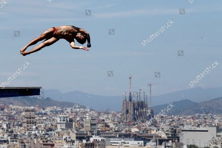 Gold medalist Qiu Bo from China performs during the men's 10-meter platform final at the FINA Swimming World Championships in Barcelona, Spain