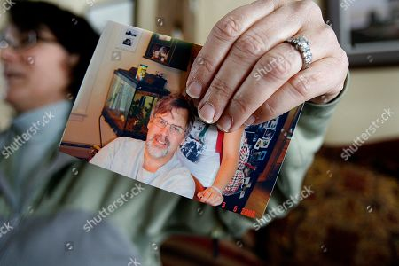 Andrea Phillips holds a photo of her husband, Capt. Richard Phillips, at her home in Underhill, Vt. Phillips is the captain of the U.S.-flagged cargo ship Maersk Alabama which was hijacked by Somali pirates off the Horn of Africa