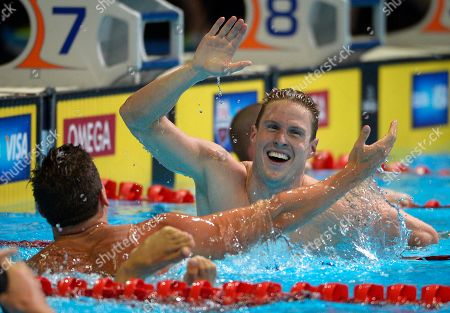 Stock Photo of Scott Weltz, Eric Shanteau. Scott Weltz celebrates with Eric Shanteau, left, after winning the men's 200-meter breaststroke final at the U.S. Olympic swimming trials, in Omaha, Neb
