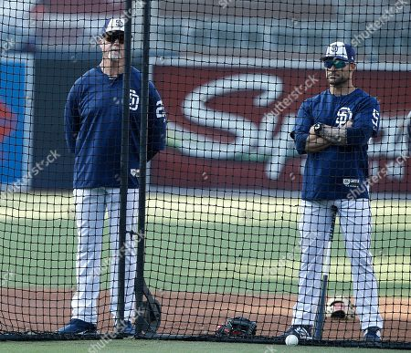 Mark McGwire, Skip Schumaker. San Diego Padres bench coach Mark McGwire, left, and first base coach Skip Schumaker watch batting practice during warmups before a baseball game against the Colorado Rockies in San Diego